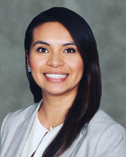 Cristina Revelo headshot on Affiliated Monitors' standard photo backdrop